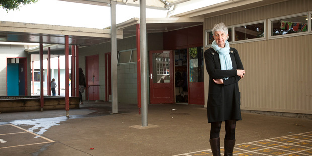Westmere Primary School principal Carolyn Marino in front of the leaky school buildings. Photograph by Michelle Hyslop