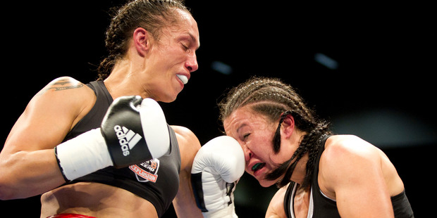 Kaikohe's Daniella Smith, left, and her daughter Talia have created history by being the first mother and daughter combination to fight on the same fight card. Daniella is pictured here during her loss to Arlene Blencowe six months ago.