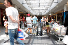 Christmas shoppers flocked to Westfield St Lukes yesterday. Photo / Chris Gorman
