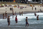 Rain is forecast for Mt Maunganui this weekend, making today the best bet for a swim. Photo / Alan Gibson