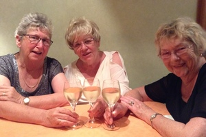 The Picton girls, from left: Aileen, Lynne and Marlene - with their glasses of Vin d'Alsace. Photo / Justine Tyerman