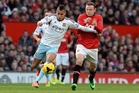 West Ham United's talented Ravel Morrison, left, battles Manchester United's Wayne Rooney for the ball. Photo / AP