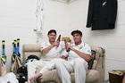 Brendon McCullum and Tim Southee of New Zealand celebrate in the dressing room after winning the third test matc. Photo / AP