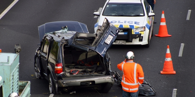 One person was seriously hurt when this vehicle rolled on the motorway to Auckland Airport. Photo / SNPA