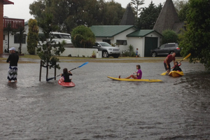 Holiday makers take to their kayaks in the centre of town at Pauanui. Photo / Jo Hosking
