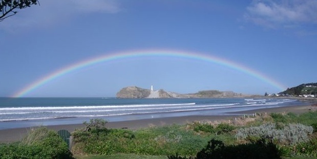 Rainbow over the lighthouse at Castlepoint.