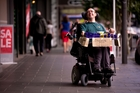Mark Grantham has been selling chocolate for charity from his wheelchair for more than 20 years. Photo / Dean Purcell