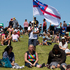 An man flies the United Tribes flag during the Waitangi Day celebrations at Bastion Point in Auckland.  Photo / Greg Bowker