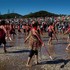 Women and men performed haka on the beach before boarding their Waka in the Bay of Islands during Waitangi celebrations today. Photo / Sarah Ivey