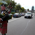 Piper Mev Appleton pipes the hearse along Parnell Road, at the funeral of Sir Paul Holmes, at the Holy Trinity Cathedral. Photo / Brett Phibbs