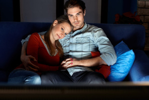 Cuddle up with food, wine and a romantic flick.Photo / Thinkstock