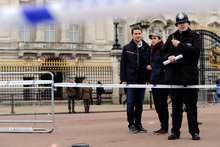 A cornered off area containing knives, a hat and Taser wire outside Buckingham Palace in central London. Photo / AP