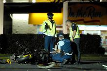 Police investigate the motorbike crash. Photo / Herald on Sunday