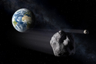 An artist's impression of ancient asteroid 2012 DA14, which will bypass Earth next week. Photo / ESA - P.Carril/Supplied