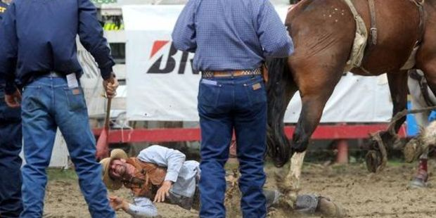 Loading Cam Billing, of Te Awamutu, lies injured after being bucked into the back of a stall at the Outram Rodeo yesterday. Photo / Craig Baxter