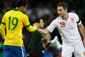 England's Frank Lampard, right shakes hands with Brazil's Fred, at the end match during following their international soccer game at Wembley stadium in London. Photo / AP