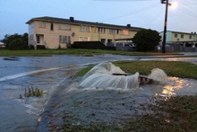 Water overflows onto a Wellington street. Photo / Adam Woollett