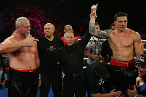 Sonny Bill Williams celebrates winning his fight against Francois Botha in their heavyweight bout. Photo / Getty Images.