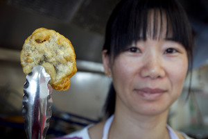 Lidong Xu displays a deep-fried chocolate chip cookie.  Photo / Natalie Slade