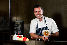 Chef Sean Marshall from Roxy has recently opened a gourmet hotdog stand in Imperial Lane. Photo / Babiche Martens