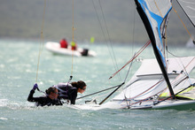 Alex Maloney and Molly Meech have their hands full in their 49er. Photo / Chris Gorman
