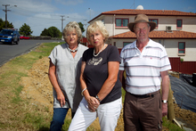 Concerned residents (from left) Annabel Haddrell, Raewyn Roberts and David Price are among at least 260 homeowners who will be affected by the Auckland Transport proposal. Photo / Natalie Slade