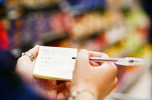 Not sticking to your shopping list can quickly ruin your budget. Photo / Getty Images