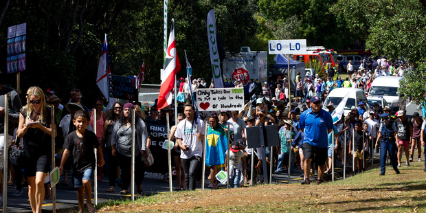 Members of the anti family violence hikoi march up the hill to the Treaty Grounds during Waitangi celebrations. Photo / Sarah Ivey