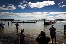 A fleet of waka makes a spectacular arrival at Waitangi for the celebrations. Photo / Sarah Ivey
