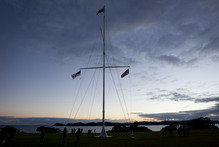 The flagpole stands on the Treaty Grounds at Waitangi during the Dawn Service to mark Waitangi Day.Photo / Sarah Ivey
