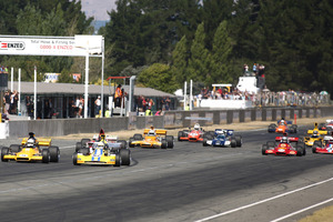 The F5000 field powers into the first turn on Sunday. Picture / Fast Company, Alex Mitchell
