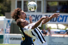 Auckland's Albert Riera (left) and Team Wellington's Henry Fa'arodo tussle at Kiwitea St yesterday. Photo / Natalie Slade
