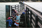 Time spent with youngsters on the wharf is time well invested.  Photo / Geoff Thomas