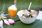 Garlic clams and mango vanilla cream. Photo / Doug Sherring