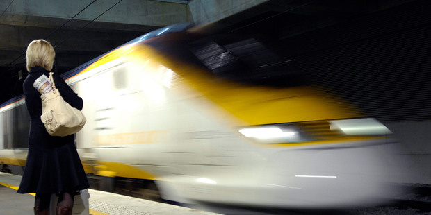 A passenger waits as a Eurostar train arrives at Ebbsfleet, Kent, England. Photo / Bloomberg