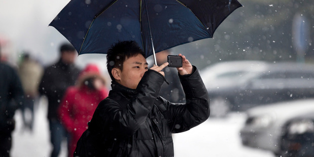 There are a staggering one billion mobile phone subscribers in China. Photo / AP