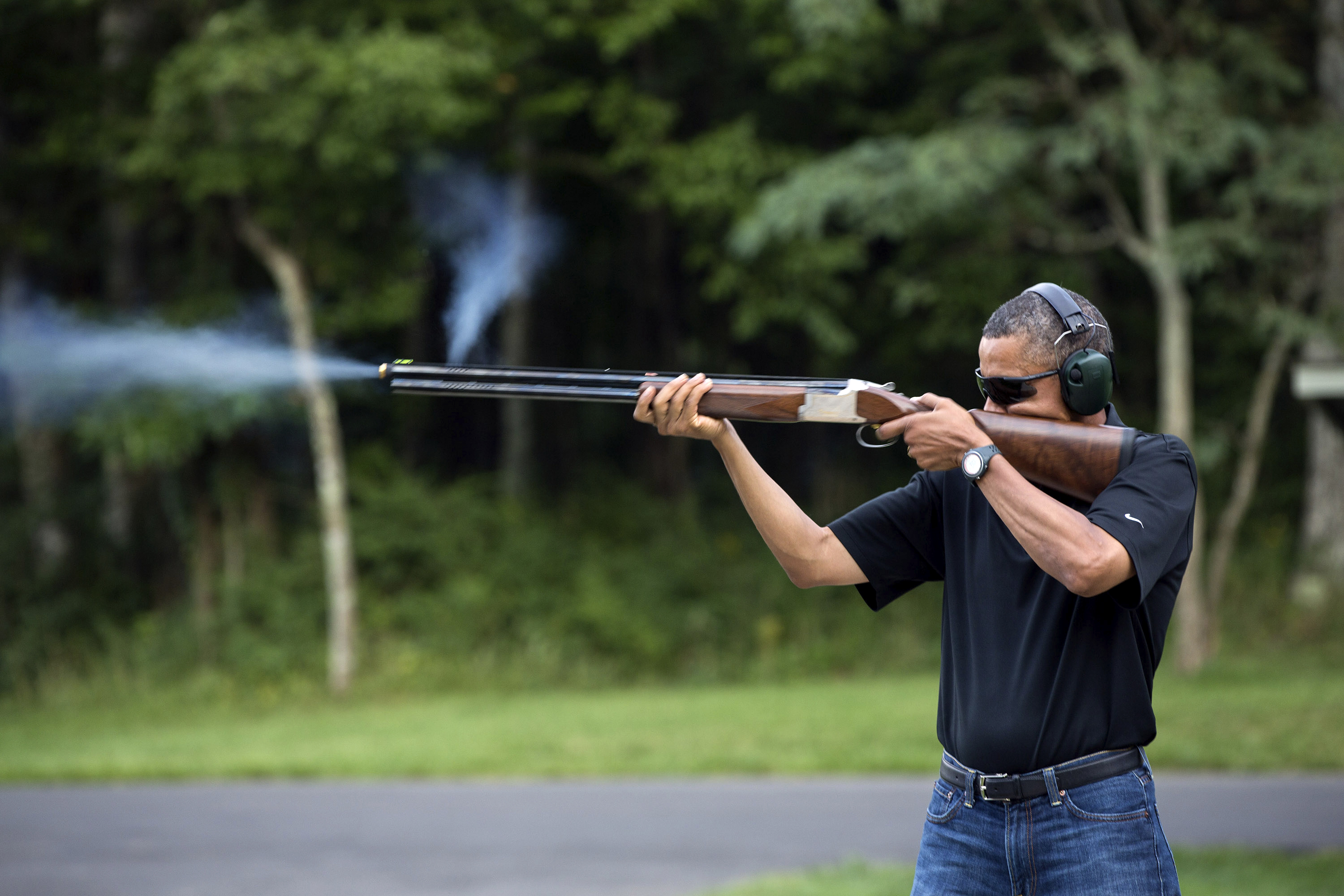 In this photo released by the White House, President Barack Obama shoots clay targets on the range at Camp David, Md., Saturday, Aug. 4, 2012. The White House released a photo of Obama firing a gun, t