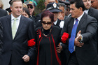 Prime Minister John Key is lead onto the marae by Titewhai Harawira in 2012. Photo / Natalie Slade