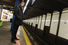 Jack Tame waits in New York's subway.  Photo / Getty Images
