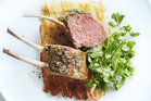 Green peppercorn-crusted lamb rack with crunchy potatoes. Photo / Chris Court, Donna Hay Magazine