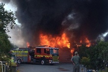 Equipment including a tractor and forklift was destroyed in a $250,00 fire at GardenBarn in Masterton yesterday afternoon. Photo / Supplied