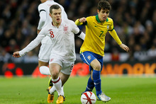 England's Jack Wilshere, left, battles for the ball with Brazil's Oscar during their international soccer match at Wembley stadium. Photo / AP