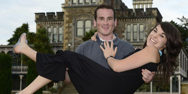 Matthew Weathers holds his fiance, Fleur Allen, after proposing at Larnach Castle on Saturday. Photo by Peter McIntosh.  Photo / Peter McIntosh/Otago Daily Times