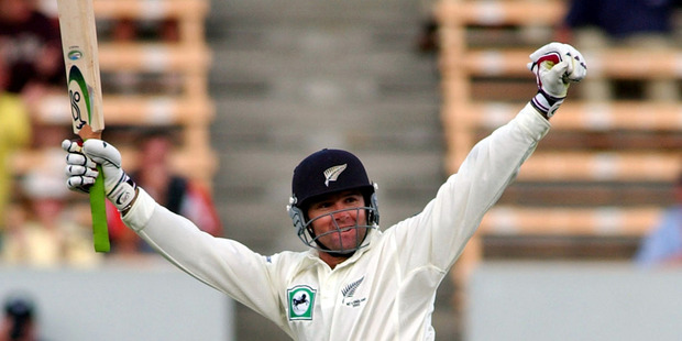 Nathan Astle celebrates bringing up his quickfire double ton against England. Photo / Getty Images