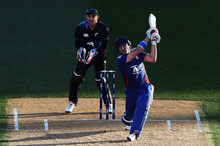 England's Luke Wright hits the ball for six. It was just one of 23 scored in Eden Park last night. Photo / Hannah Johnston