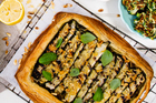 Courgette, parmesan and garlic tart with green olive dressing. Photo / NZH