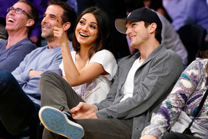 Mila Kunis and Ashton Kutcher can't wait to live together. Photo / AP