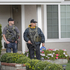 U.S. Marshals deputies stand on guard outside the home of the mother of fugitive suspect Christopher Dorner, a former Los Angeles officer in La Palma, California on February 8. Photo / AP
