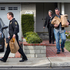 Police investigators take away evidence from the home of the mother of fugitive suspect former Los Angeles police officer Christopher Dorner, in La Palma, California on February 8. Photo / AP