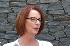 Australian Prime Minister Julia Gillard fronts a large media contingent at the Hilton Queenstown. Photo / Otago Daily Times